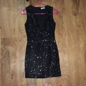 Low cut black sequin dress